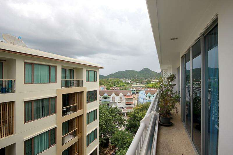 mountain view balcony condo near beach