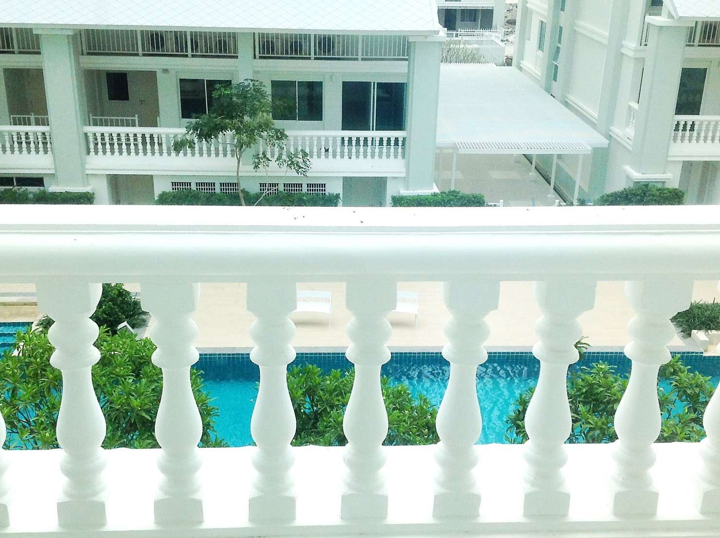 pool view balcony condo