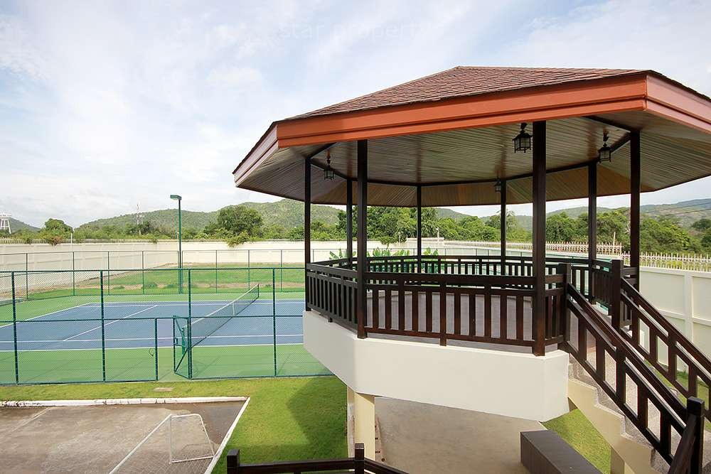 Outside area of house and see tennis court